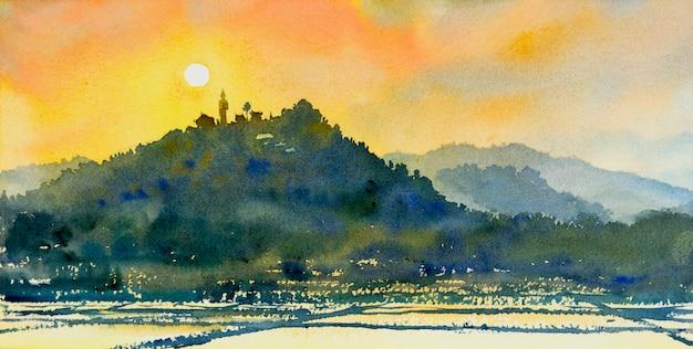 Akwarela przedstawiająca kompleks górski pola ryżowe i świątynie w pięknym wieczornym klimacie a w tle słońce, złoto, niebo.