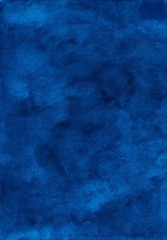 Akwarela vintage ciemnoniebieskie tło tekstura. aquarelle streszczenie stare niebieskie tło. plamy na papierze.