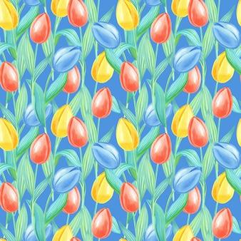 Akwarela wiosna wzór z tulipanów żółty, czerwony, niebieski. kwiaty na niebieskim tle.