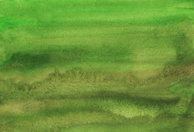 Akwarela zielone brązowe tło tekstura, plamy na papierze. kolor wody streszczenie głębokie tło świerk ręcznie malowane.