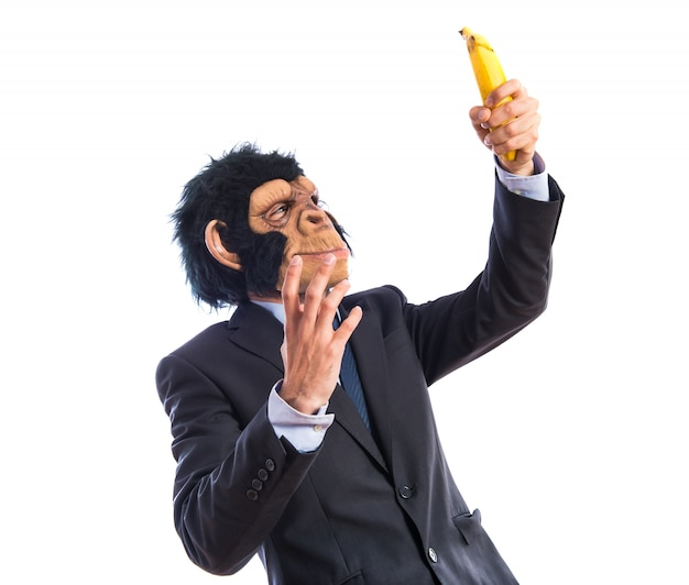 Ape człowiek zaskoczony bananem