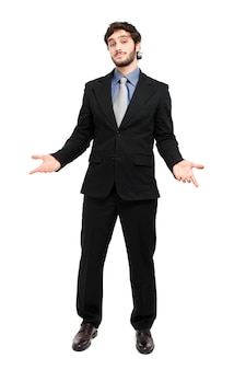 Approachable młody biznesowy mężczyzna z otwartymi rękami odizolowywać