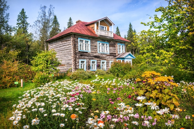 Archimandrite's wooden dacha in the botanical garden on the solovetsky islands and flowers and the north forest