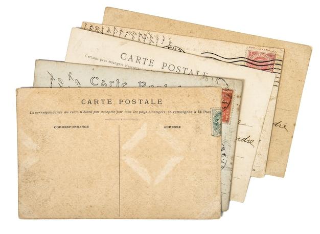 Archiwalne pocztówki. stary odręczny list mai. zużyte tło papieru