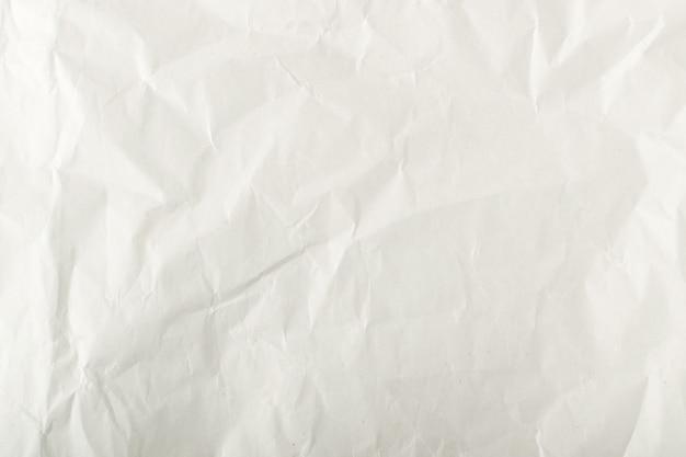 Arkusz białego cienkiego zmięty papier rzemiosła tło