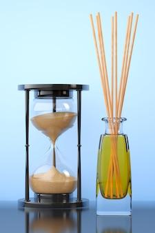 Aromaterapeutyczny odświeżacz powietrza z klepsydrą piasku na niebieskim tle. renderowanie 3d