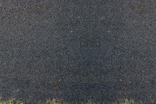 Asfalt stosowany do nawierzchni dróg lub podłóg, lokalna pokrywa ulicy z asfaltem, czarne szorstkie teksturowane tło