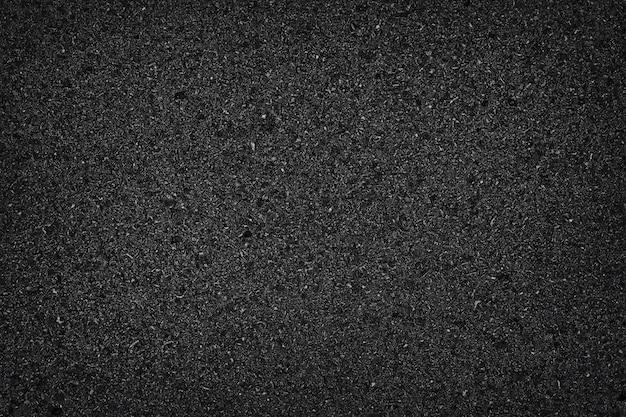 Asfaltowa drogowa tekstura z winietą dla projekta tła lub narzuta projekta drogi powierzchni odgórnego widoku