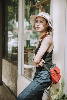Asian girl teen cute hipster style fashion portrait holiday summer travel dress vintage color film tone
