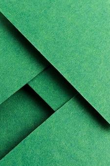Asortyment martwej natury monochromatycznej z zielonym papierem