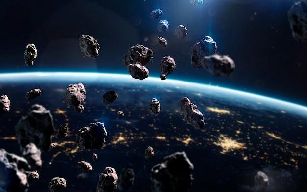 Asteroidy w pobliżu ziemi. meteoryty krążące wokół planety. obraz z kosmosu, fantasy science fiction w wysokiej rozdzielczości, idealny do tapet i druku. elementy tego zdjęcia dostarczone przez nasa
