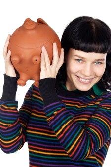 Atrakcyjna dziewczyna z pieniądze pudełkiem a nad białym tłem