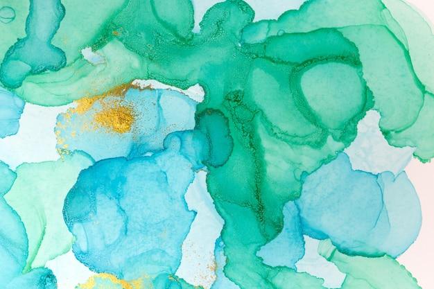 Atrament alkoholowy niebieski streszczenie tło. akwarela tekstury w stylu oceanu. ilustracja plamy farby niebieski i złoty