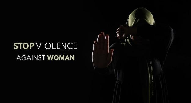 Azjatycka kobieta muzułmańska zakryj twarz ręką, koncepcja stop przemocy wobec kobiet.