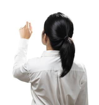 Azjatycka kobieta palec punkt nosić białą koszulę widok z tyłu na białym tle
