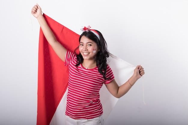 Azjatycka kobieta z indonezyjczyk flaga