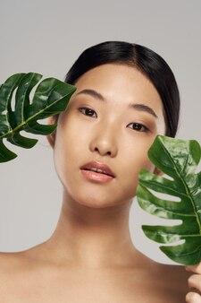 Azjatycka kobiety piękna portreta twarzy skóry opieka
