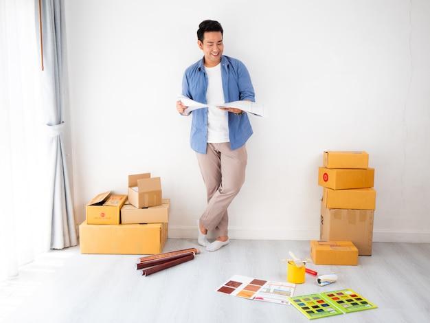 Azjatycki człowiek projektowania i myślenia do dekoracji domu