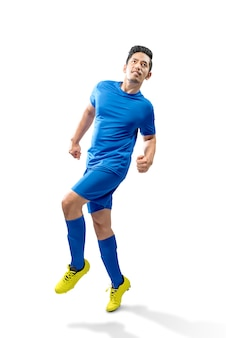 Azjatycki piłkarz człowieka w akcji