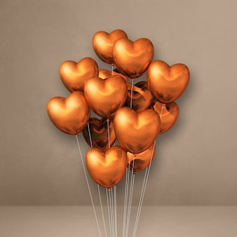 Balony w kształcie miedzi w kształcie serca na beżowej ścianie. renderowanie ilustracji 3d