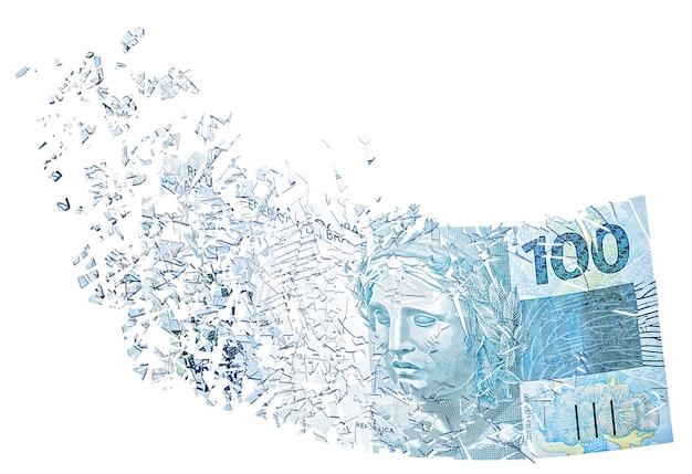Banknot 100 reali parujący w powietrzu, tracący na wartości pieniądz, kryzys finansowy i dewaluacja brazylijskiego reala.