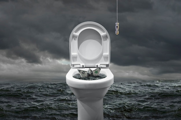 Banknot w kształcie łodzi, która ma zostać połknięta przez toaletę