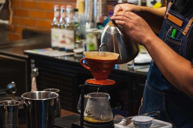 Barista making drip coffee