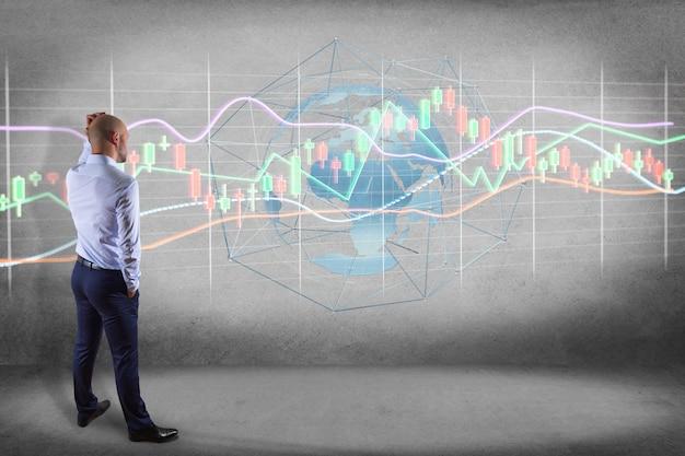 Bbusinessman przed ścianą z renderowania 3d wyświetlanie informacji o handlu giełdowym