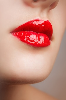 Beauty red lip makeup detail.