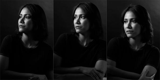 Beauty woman ma proste, czarne włosy i wyraża silne uczucie samotności. azjatycka dziewczyna pokazuje oczy wyraz twarzy na ciemnym tle, portret pół ciała monotonny