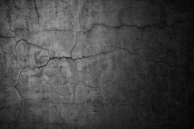 Betonowa ściana czarne tło ponury
