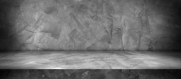Betonowa ściana i podłoga z jasnym i cieniem tła, używana do prezentacji produktów do prezentacji i projektowania banerów okładkowych.