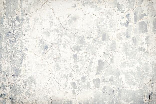 Betonowa ściana porysowana koncepcja tekstury tła materiału