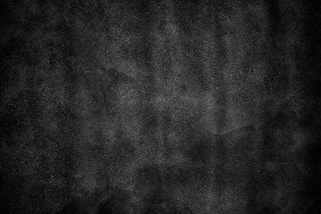 Betonowa ściana tekstury powierzchni miejskiego czarnego cementu jako tło