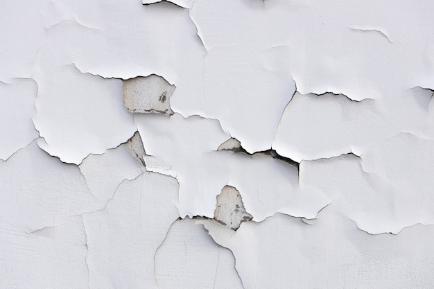 Betonowa ściana z białą popękaną farbą. zdjęcie wysokiej jakości