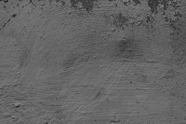 Betonowa ściana z pęknięciami i zadrapaniami