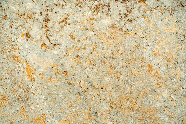 Betonowa tekstura. stare, zabytkowe tło złoto. pomarańczowy z szorstkością i pęknięciami.