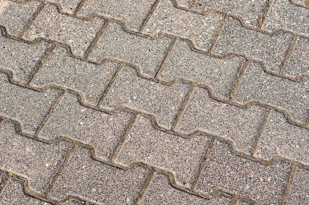 Betonowe cegły chodnik tło