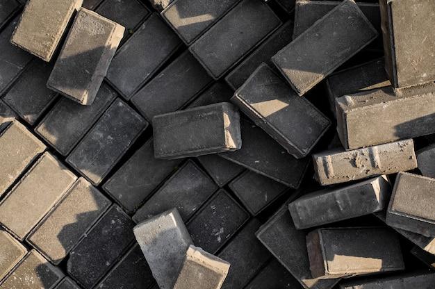 Betonowe płyty chodnikowe. tło bezpłatnych niezapłaconych kostek brukowych