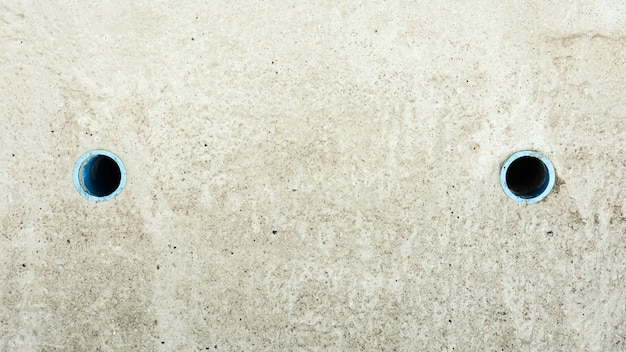 Betonowe pokrycie kanalizacji tło