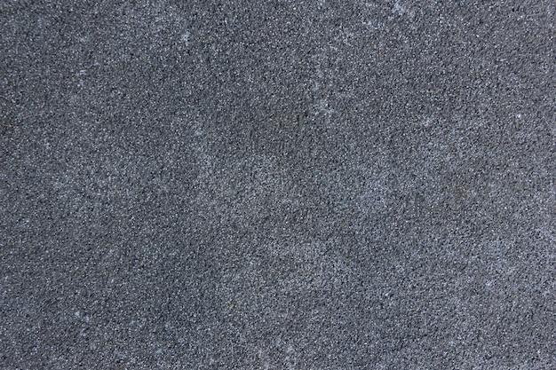Betonowe tło. naturalna ciemnoszara tekstura kamienia. ściana z miejsca na kopię.