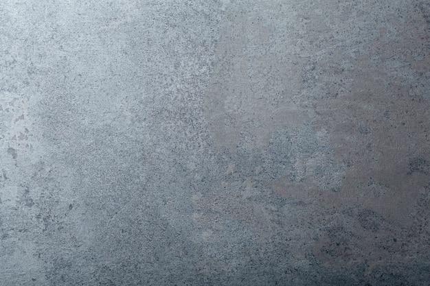 Betonowe tło. powierzchnia betonowa o fakturze zarówno kamienia, jak i cementu. skopiuj miejsce