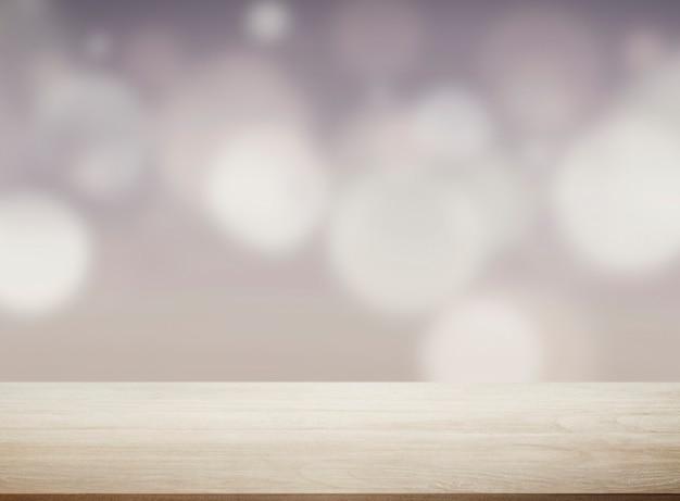 Beżowa drewniana deska ze światłami bokeh