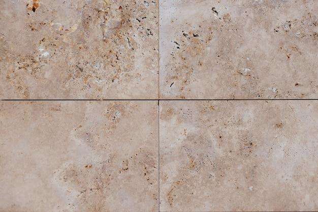 Beżowa ściana betonowa. płytka tekstury piaskowca