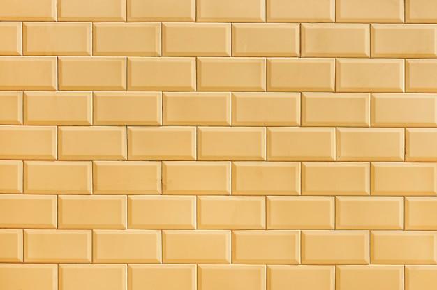 Beżowa ściana z cegieł tła tekstura