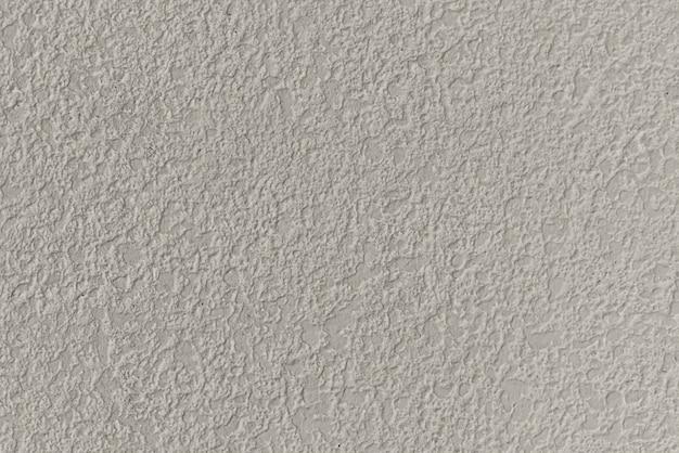 Beżowe gładkie tło z teksturą betonu