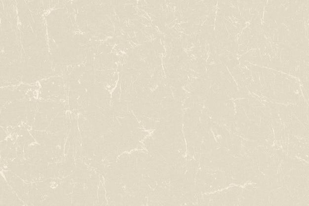 Beżowe porysowane marmurowe teksturowane tło