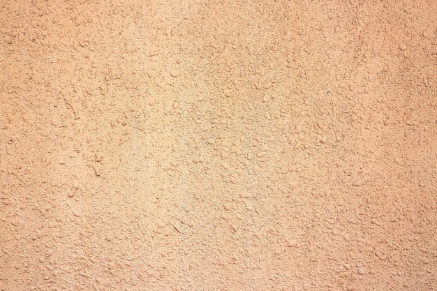 Beżowe tło cementu. ściana tekstura tło