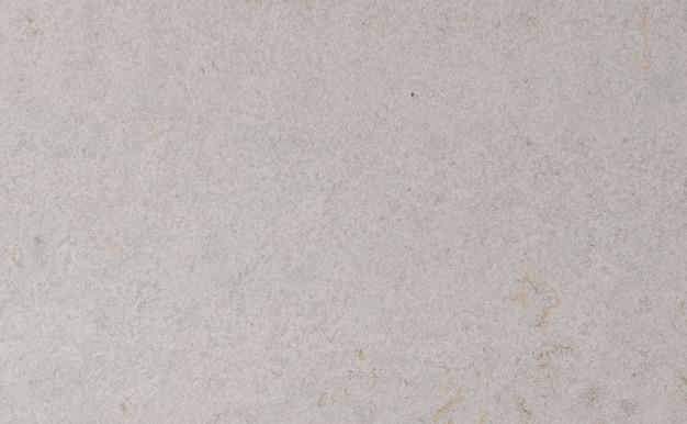 Beżowe tło kamień, naturalne tekstury z bliska trawertyn