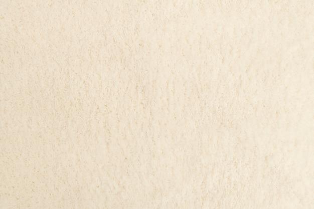 Beżowe tło z teksturą tkaniny z przestrzenią projektową